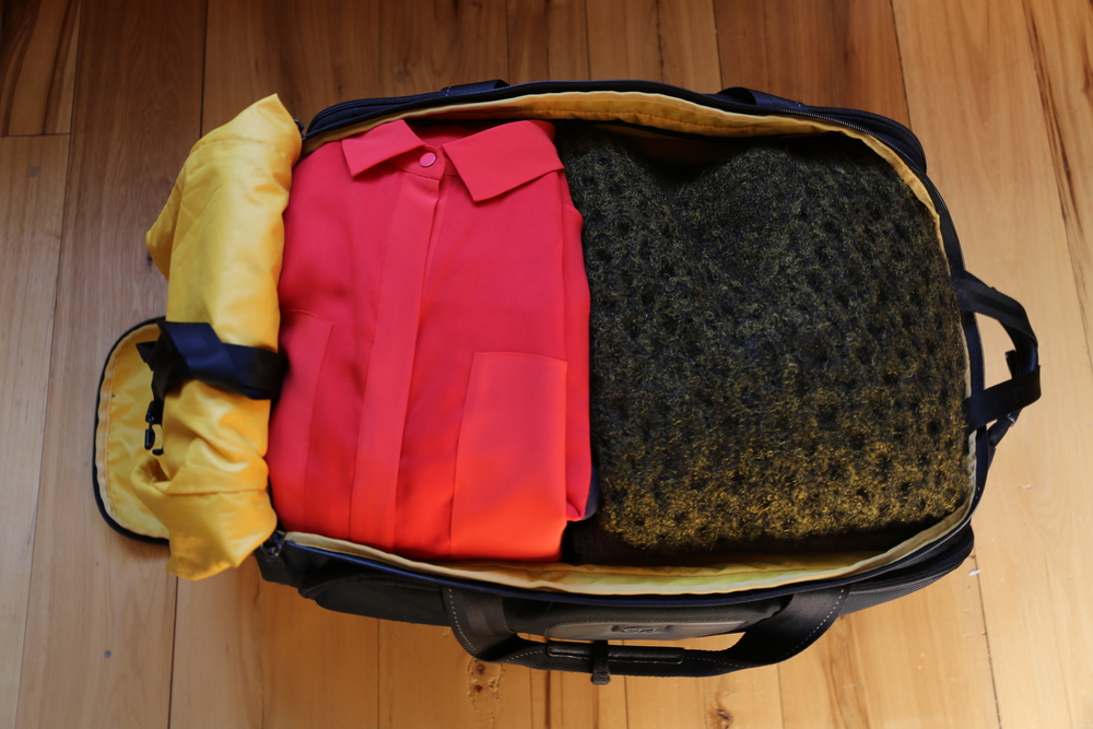 VANESSA-BELETIC-MINIMAL-PACKING-ISABEL-MARANT-SWEATER-TUMI-BAG-WANG-SHIRT.JPG