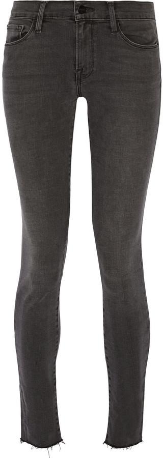 frame-denim-le-skinny-de-jeanne-frayed-mid-rise-jeans.jpg