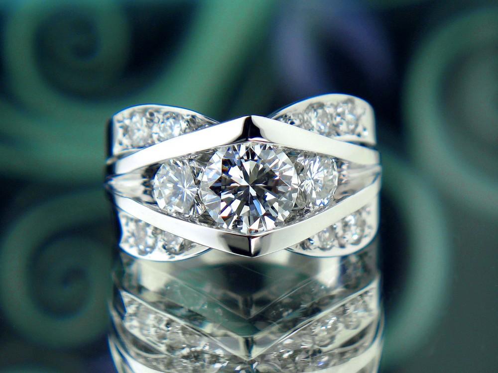 Custom White Gold Three Stone Ring with Prong Set Diamonds