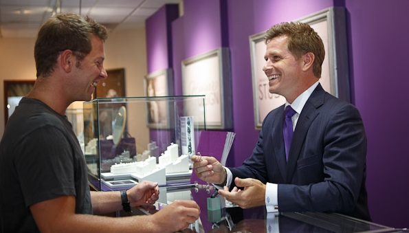 Chief Romance Officer Craig Husar with engagement ring customer