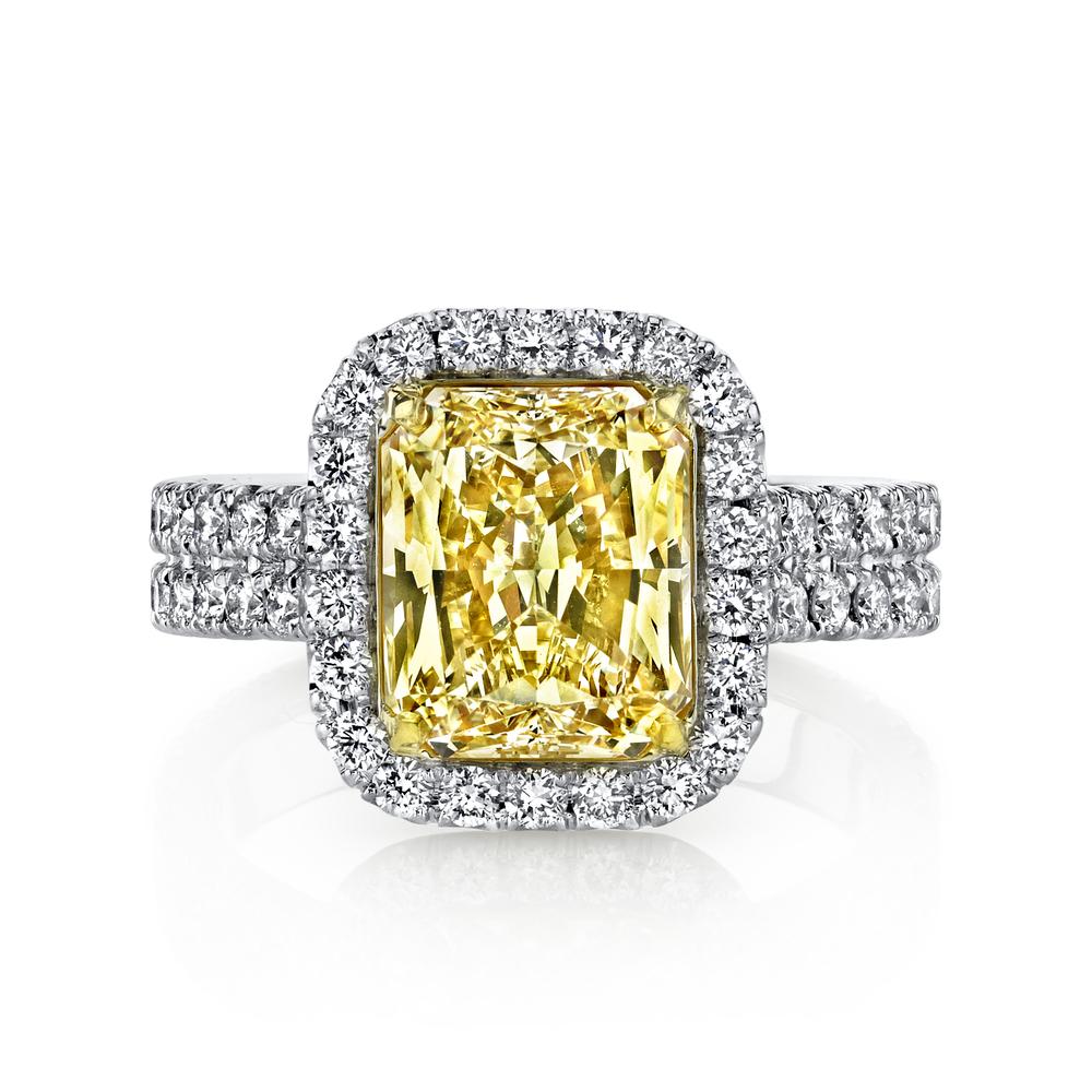 Spectacular Husar Signature3.01 carat Fancy Yellow Diamond in hand-crafted, 1.07 cttw,platunum mounting. Retail $58,599 Husar Price $46,999