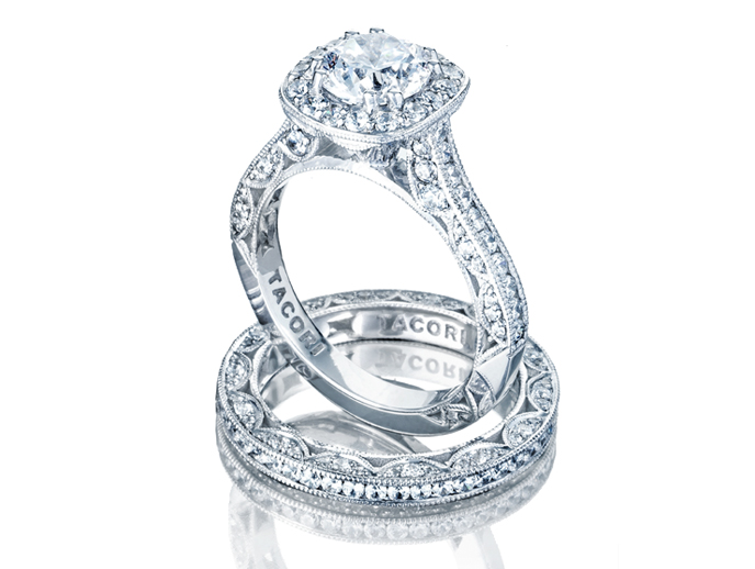 Classic Crescent Collection by Tacori For the lover of all things classic, this collection started it all with the iconic Tacori crescents set with diamonds on the inner face of the ring. The crevices between each crescent reflect the brilliance of the diamonds placed within each design. Coming in a variety of romantic ribbon bands or straight classic bands.