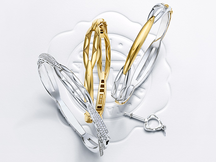 The Promise Bracelet - These unique intertwining bracelet designs represents the unity of a Promise. Each golden pillar represents the relationship pillars of Love, Support and Mutual Respect. The Promise bracelet must be locked and unlocked with a Tacori Key, which symbolizes the Promise that is made. Once the bracelet is fastened, only the key holder can unlock the Promise.