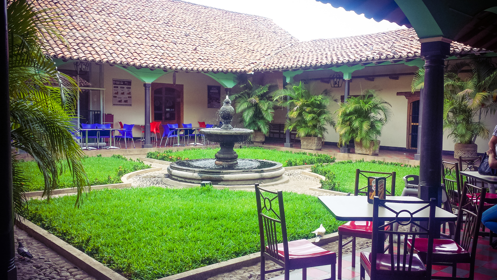 Courtyard inside a food court. In Leon, business have to maintain the colonial structure and look of any building they own.