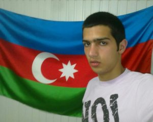 Jabbar Savalan, 19-year-old political activist imprisoned in Azerbaijan poses with Azerbaijani flag. Photo taken from his personal archive.