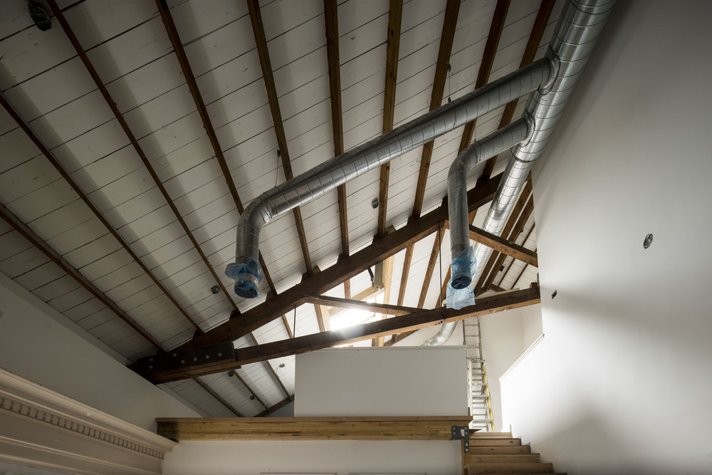LOFTY EXPECTATIONS. The open loft area, which overlooks the studio, will serve as a shooting space and a styling area. The beautiful skylight is designed for compelling light and shadow in the set all day long.