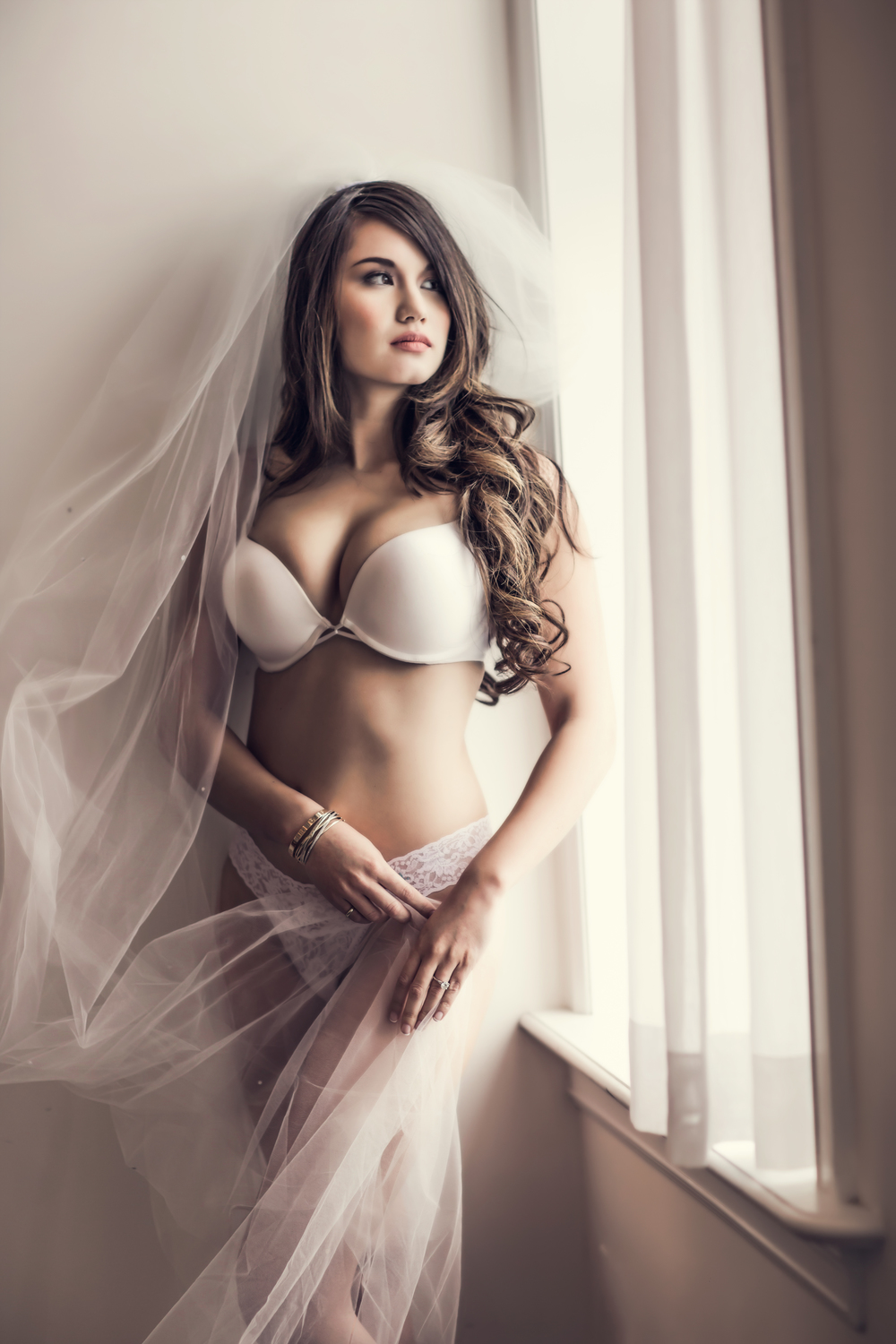 Soft and feminine in this classic bridal boudoir session. Our studio provides a variety of lengths in veil. Our client chose a cathedral veil for high drama. Wardrobe: Victoria's Secret and Nordstrom.