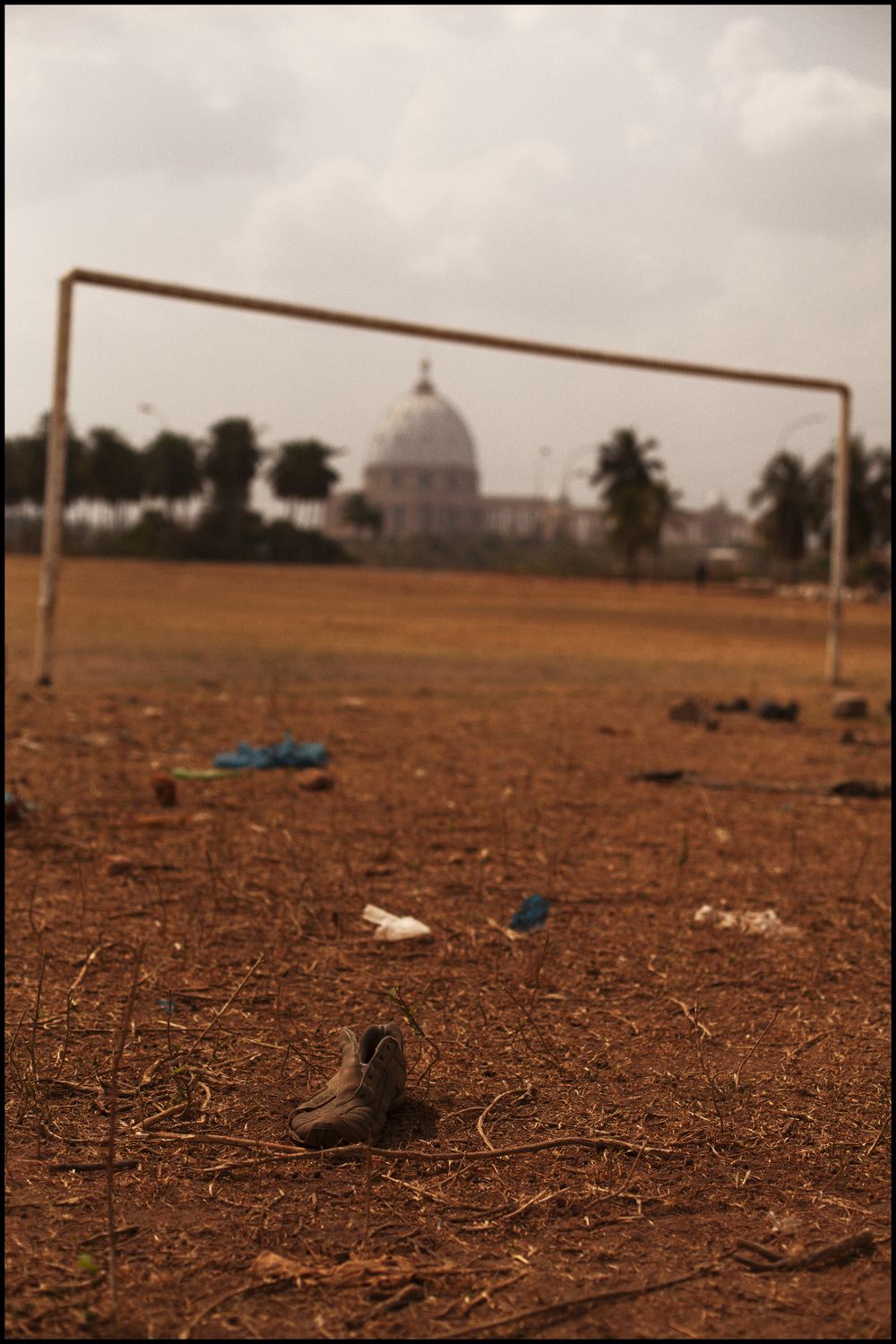 an abandoned soccer shoe at a field (Yamassoukro, Ivory Coast).jpg
