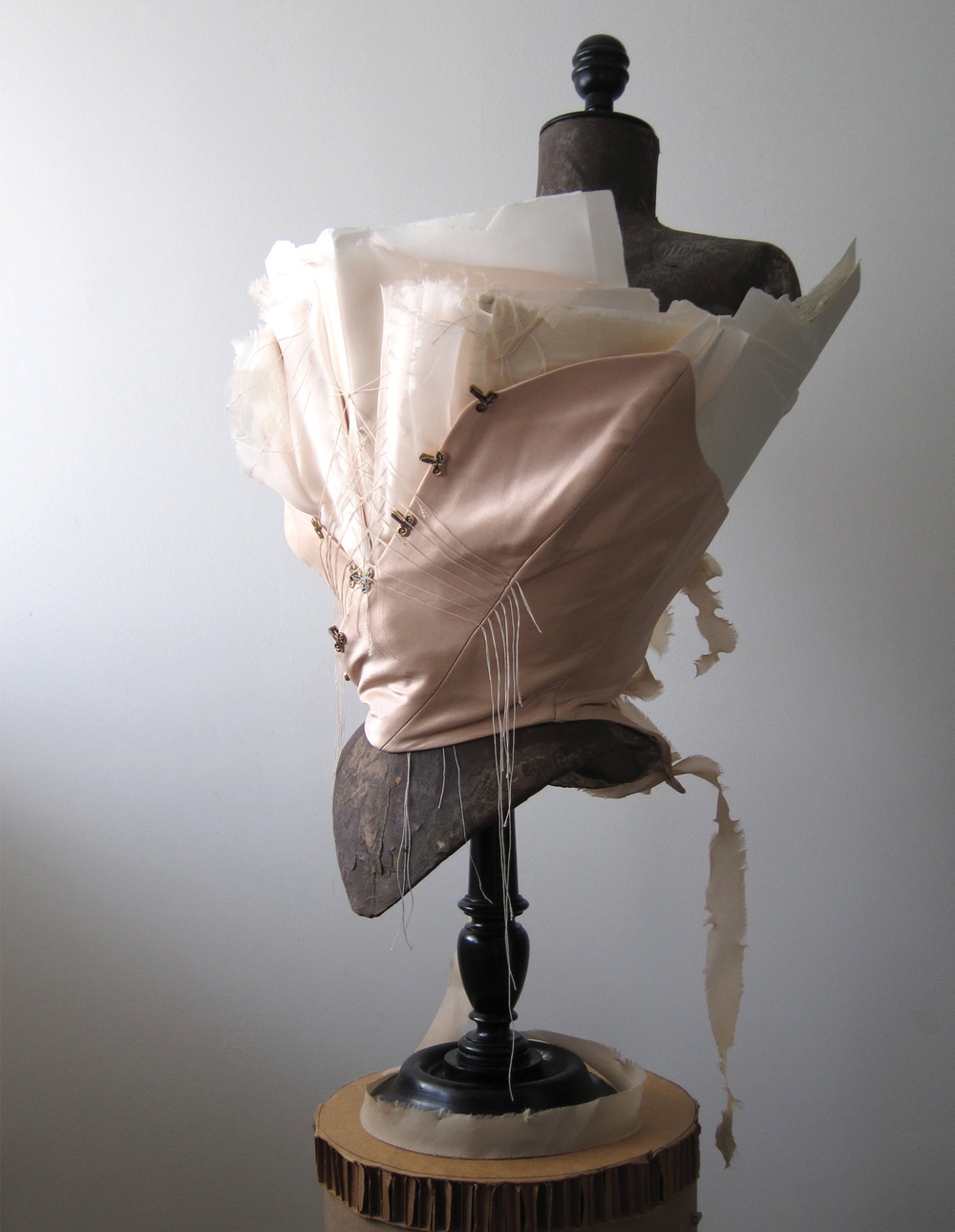 Silk corset, steel coil boning, signatures of 100% cotton paper stitched in silk.