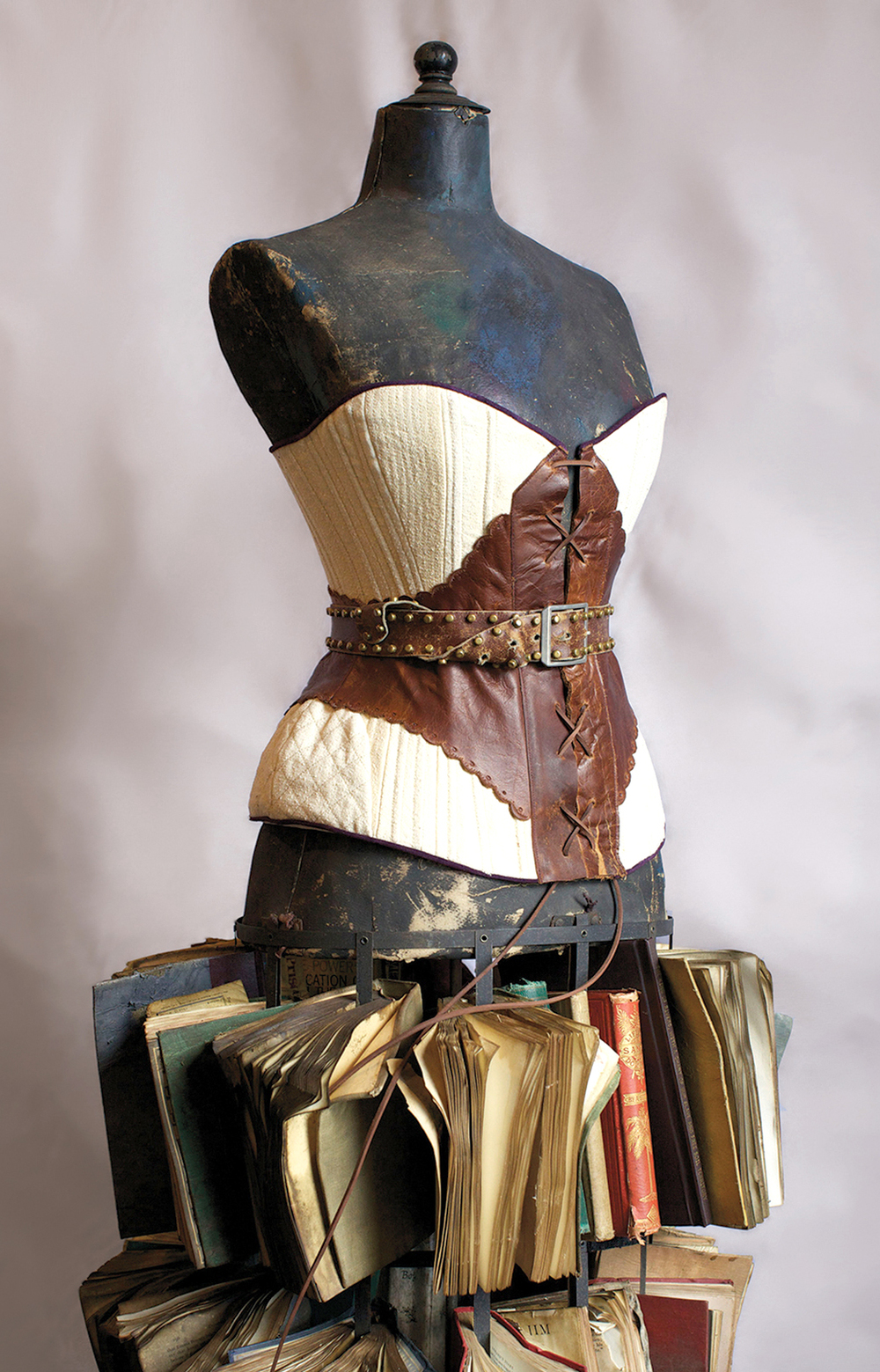 Photo: Seth Tillett Materials: Cotton and leather corset, cane boned with trapunto and coffee dyed books