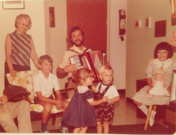 Home with family and friends in the 80s.  I'm the one in the blue dress!