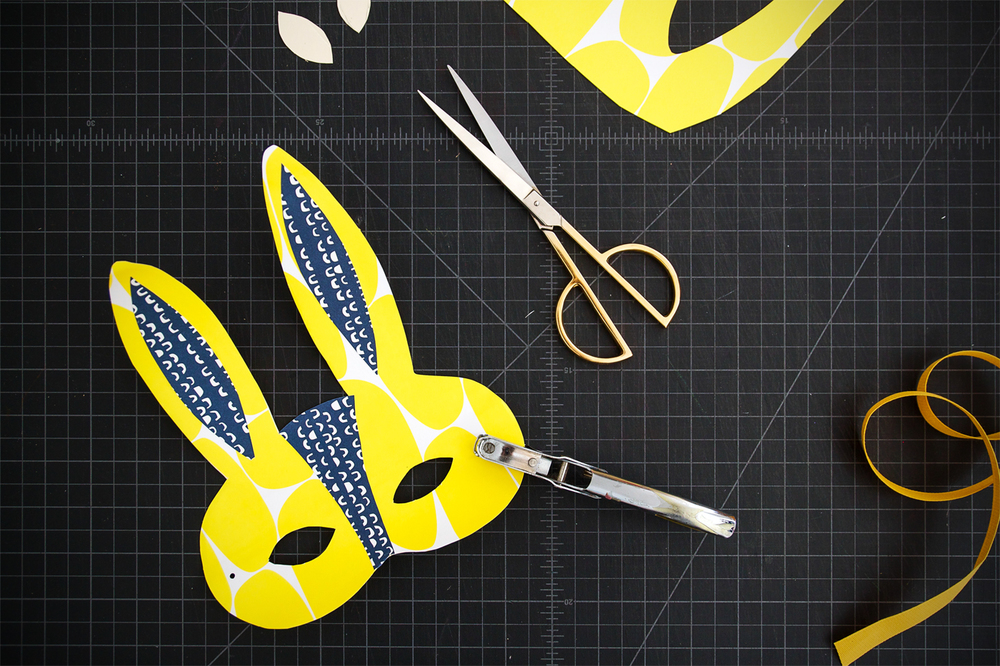 Step 6: Punch holes into the sides of your mask.