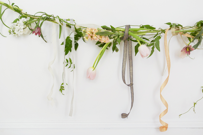 Above: A section of our finished garland draped in a simple arch on a white wall at Studio Carta. You could also hang it from the ceiling or, for a centerpiece, lay it down the length of a table.