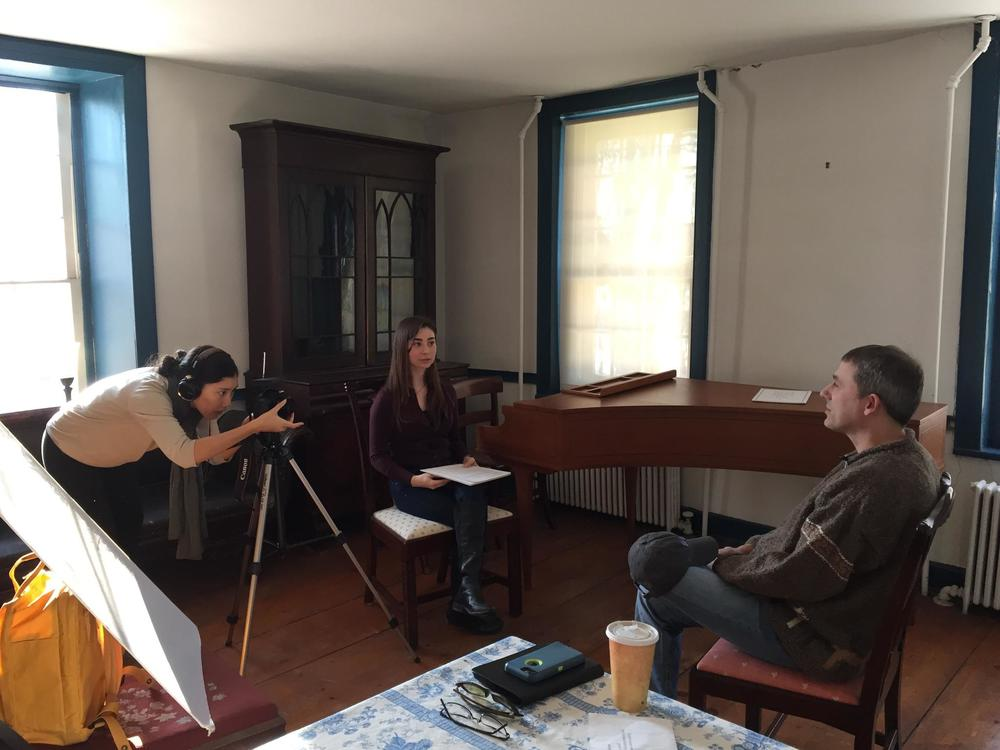 Interns interviewing and filming local historian A.J. Schenkman for Stories From Stones.