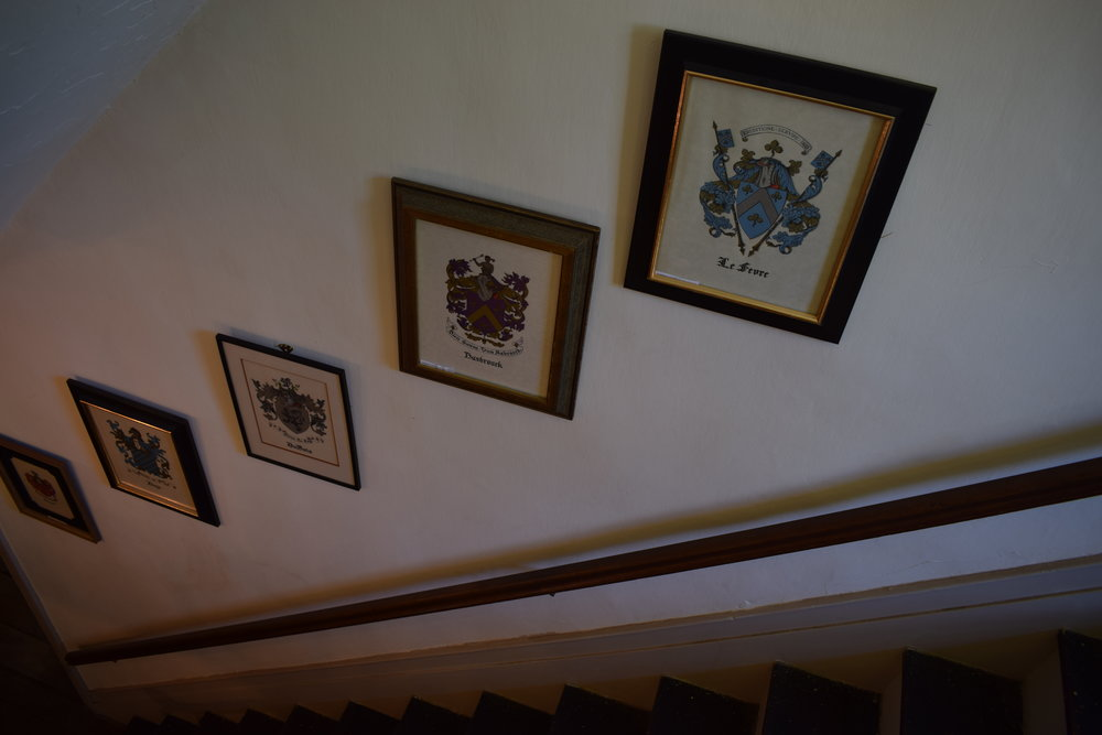 Family crests line the walls at the DuBois Fort