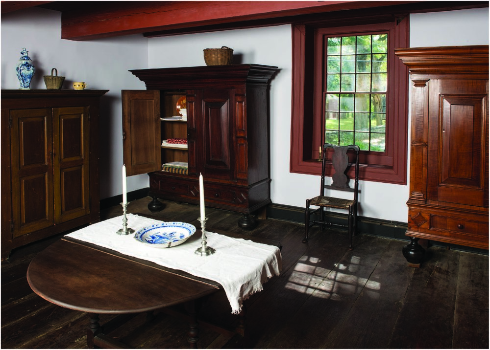 "Installation ofkasten at the Jean Hasbrouck House, showing left to right a ""country"" kast on loan from Jeffrey and Sue Hoffman and kasten from the HHS Permanent Collection and the Reformed Church of Kingston."