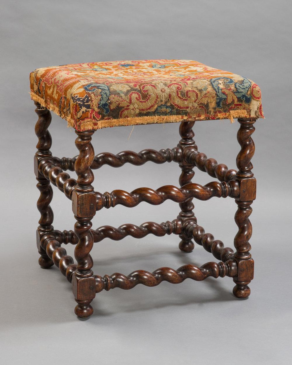Upholstered foot stool, (Gistoffeerde voeten brankje) walnut, barley, or sugar twist frame, 1670-1685, Netherlands. Photo by On Location Studios, Poughkeepsie, NY, 2017. Courtesy Historic Huguenot Street.