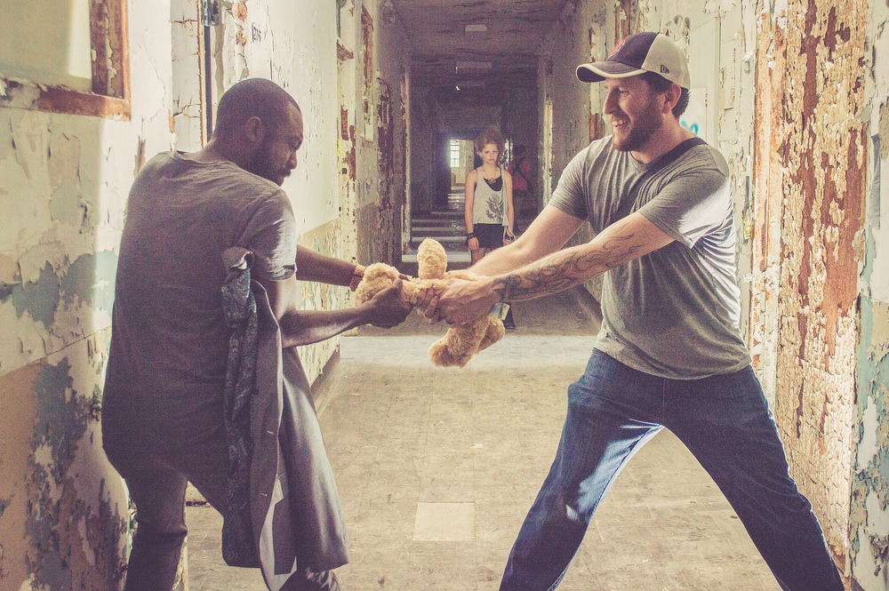 Vic Mathews and Matthew Magbee  ripping teddy bear apart for a creepy shot.