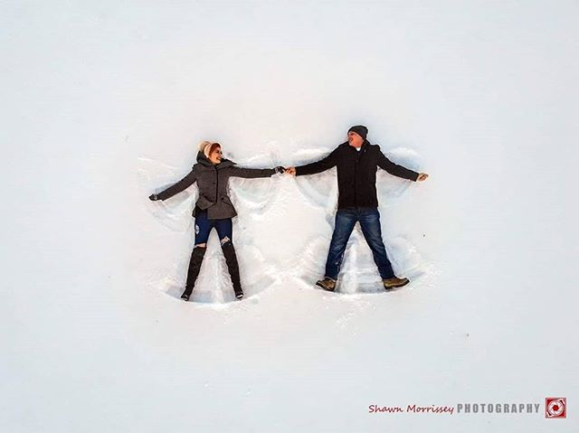 "An engagement is the perfect time for snow angels! # "" BEST JOB I EVER HAD!"" # #HypeBeast #vscoportrait #ig_mood #discoverportrait #portraitphotography #profile_vision #bleachmyfilm #postmoreportraits #portraitpage #igpodium_portraits #snowangels #dronephotography #thatsdarling #loveauthentic #engaged #greenweddingshoes #chasinglight #djimavicair #weddingseason #smpweddings #grandforks #grandforksphotographer #engaged #clickwithshawn"