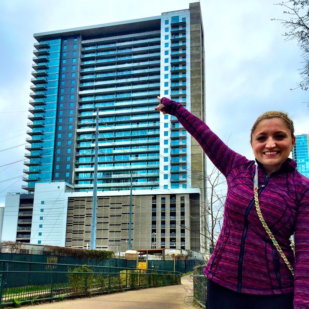 We took this photo just moments after we signed the lease at our new condo at the Seaholm!