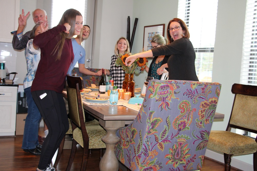 This is the family - attempting to pray without laughing at one another while Ron staged a photo!