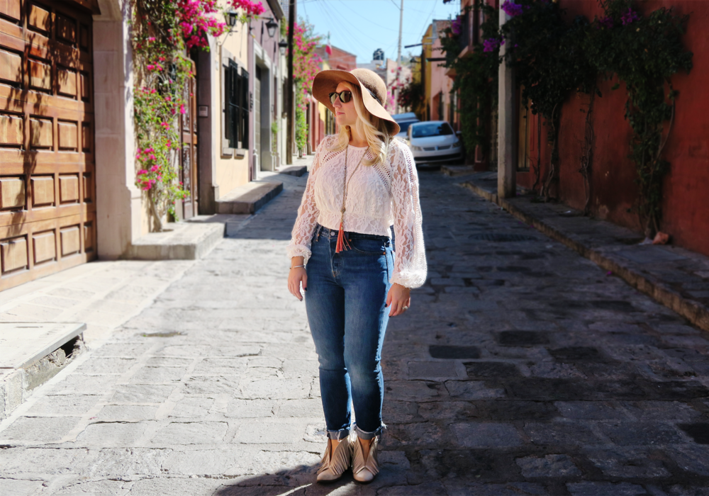 On the cobblestone streets of San Miguel Fringe Boots: Free People  High-waisted jeans: Levi's (Anthropologie)