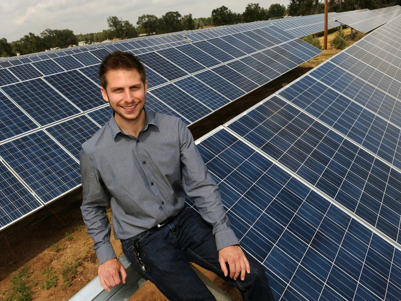 "David Amster-Olszewski, founder of SunShare, at one of the ""solar gardens"" his company built in Colorado (Helen Richardson, Denver Post)"