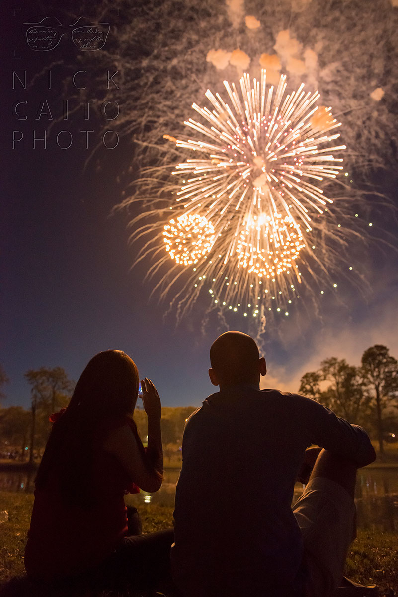 Lying down on the ground, catching the right angle for these siblings watching the fireworks in silhouette. f/3.5, ISO 3200, 1/40s.