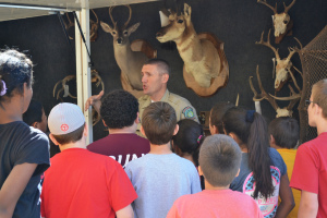 A Texas Parks and Wildlife game warden teaching students about wildlife.