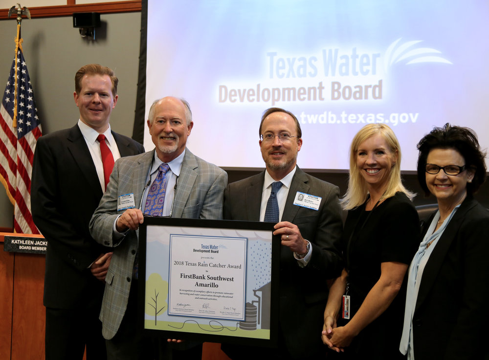 FirstBank Southwest Chairman of the Board Smith Ellis and Chief Lending Officer Will Miller accept the 2018 Texas Rain Catcher Award during the March 28 Texas Water Development Board (TWDB) meeting in Austin. Shown with them (L-R) are TWDB Chairman Peter Lake, Member Brooke Paup, and Member Kathleen Jackson.  (Photo courtesy TWDB)