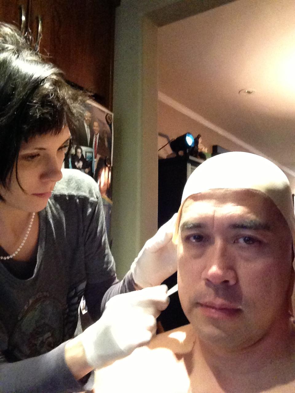 Lead Makeup FX Artist Laney Chantal applying Richard Dorton's Head mold