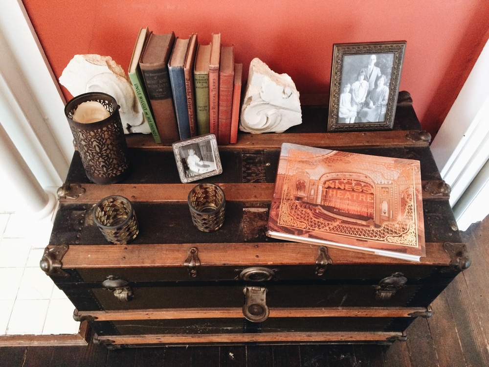 "Old family photos throughout the house create a kind of ""walking photo album"" cataloging multiple generations."