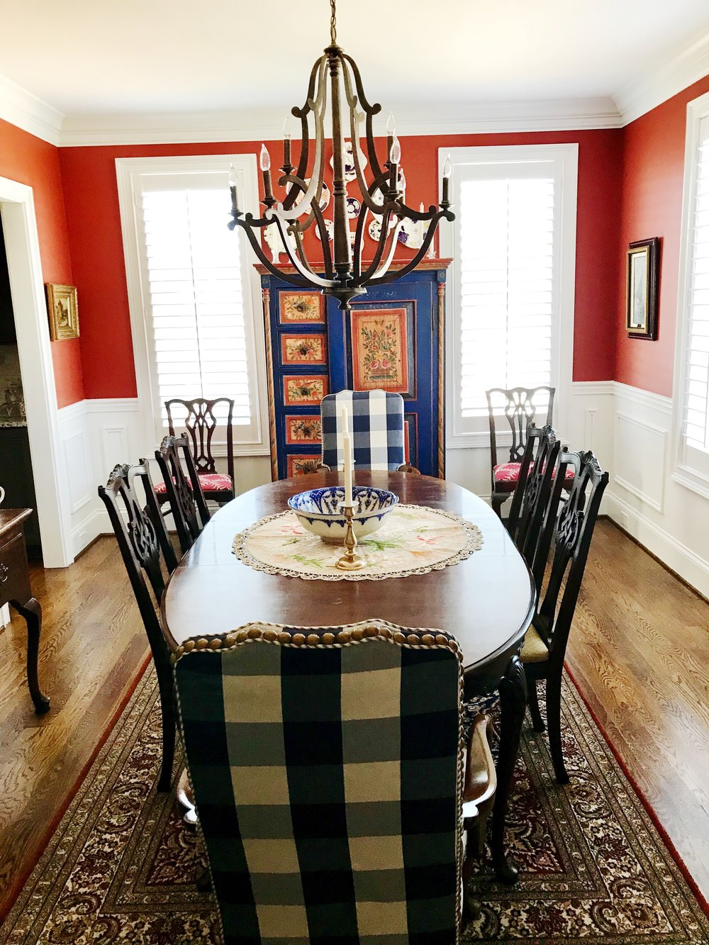 Formal dining room with an AMAZING German folk art cupboard circa 1843 at the head of the table
