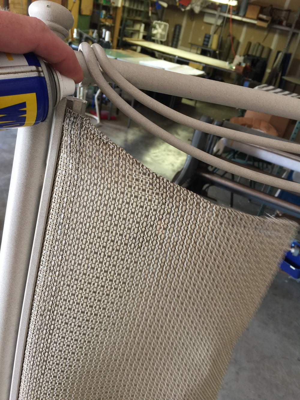 Not a necessity, but spraying silicon / lubricant down into the top of each sling rail may assist in removal. WD40 shown - silicon may be actually preferred.  Keep in mind that after many years of use and outdoor settings that small sediment is likely in the sling trac.  Again, no big deal.