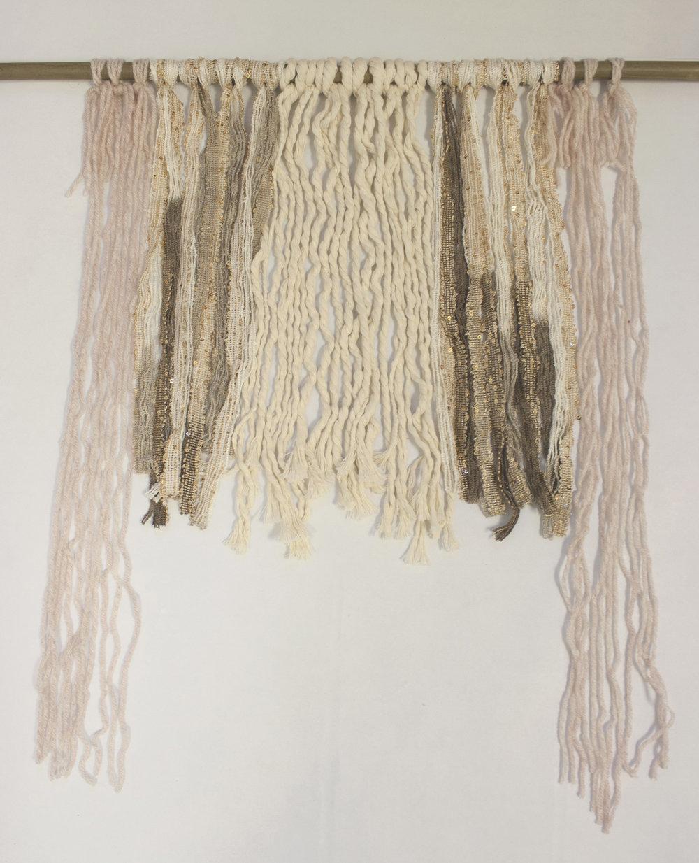 The shorter strands use Lark's Head Knots, the longer strands use regular knots