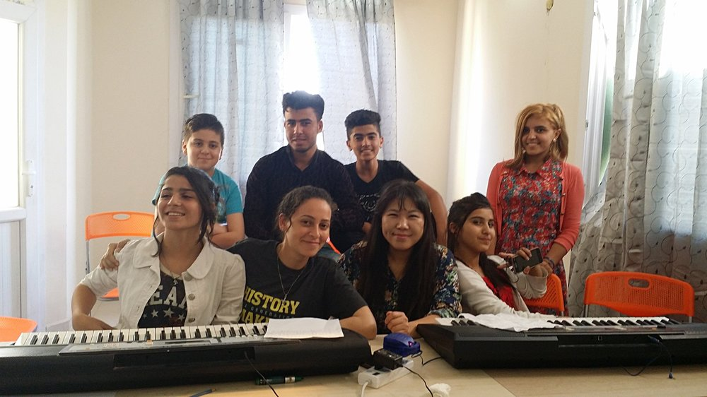Teacher Christine (middle) and her students in Erbil, Iraq.