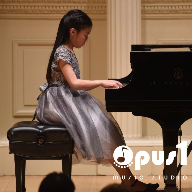 opus girl at piano (1).png