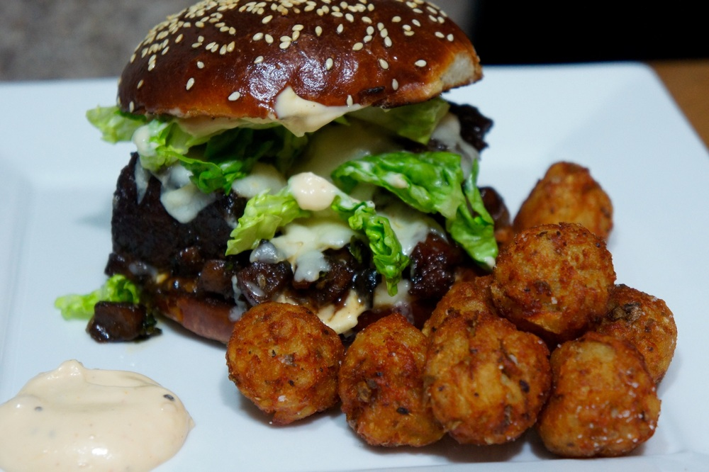 Short Rib Sandwich with Roasted Garlic Aioli and Tots.