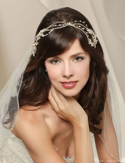 6536   Wavy headpiece with a metal leaf design