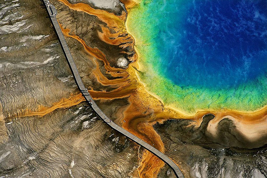 Yellowstone's Grand Prismatic Spring, Wyoming, USA    The Grand Prismatic Spring is one of Yellowstone's most popular attractions. The color is caused by bacteria that grow around the edge of the hot spring. ( via )