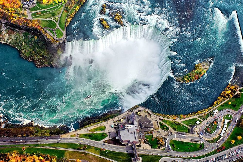 Niagara Falls    Straddling the US-Canadian border, Niagara plunges over 165 vertical feet, which gives it the highest flow rate in the world.