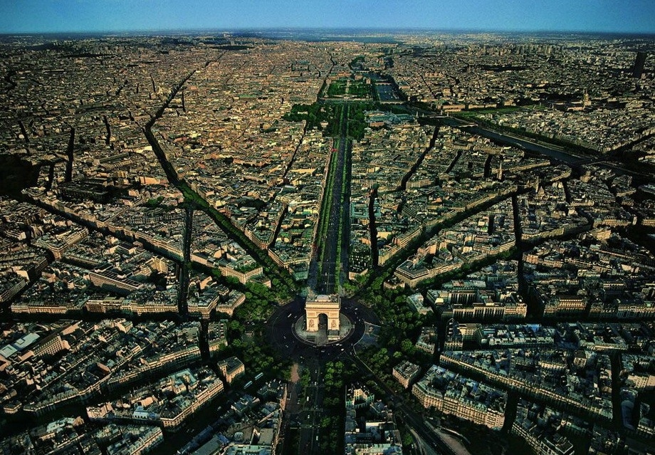 Paris, France    My guess is you could take hundreds of incredible aerial photographs of Paris, but I love this one for showing just how thick of a vein the Champs-Élysées cuts through the city.  ( via )