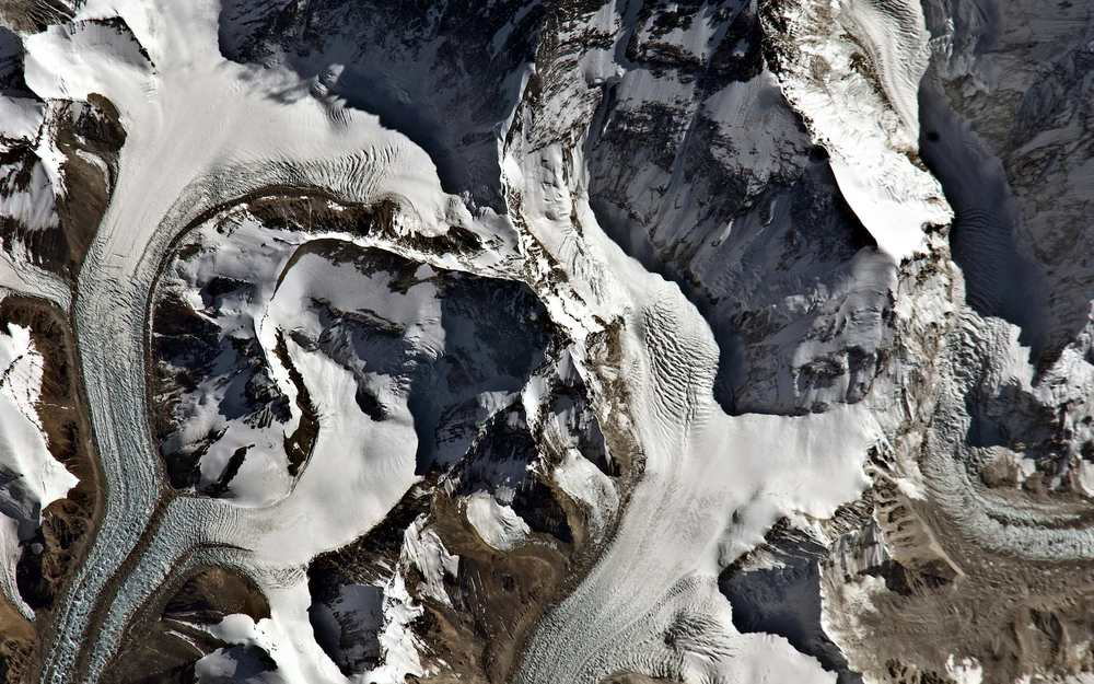 Mount Everest    A majestic swirl of glaciers and snowfields surrounds the world's highest peak. ( via )