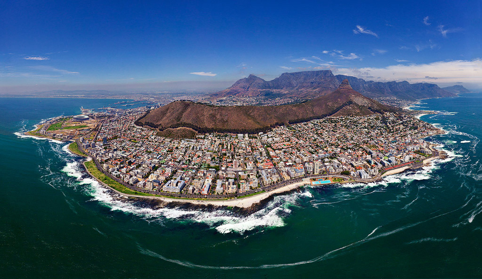 Cape Town, South Africa    I would be shocked to find out there's ever been a picture taken of Cape Town that wasn't beautiful. You can see the famous Table Mountain in the background. ( via )
