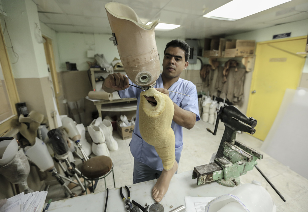 Working on prosthetics in Santo Domingo, Dominican Republic.
