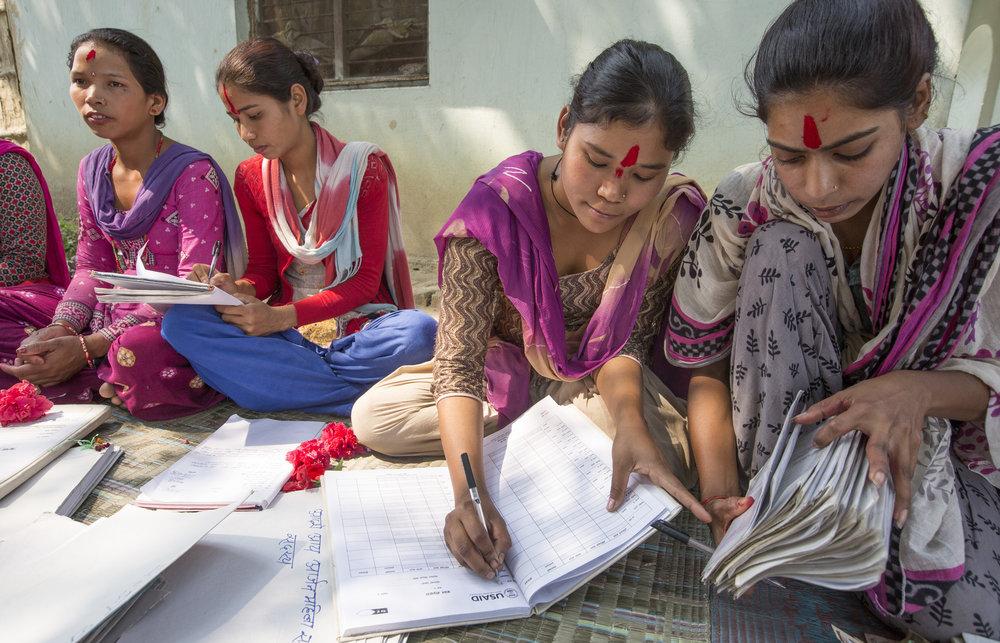 WORTH members focus on their ledgers in Nepal.