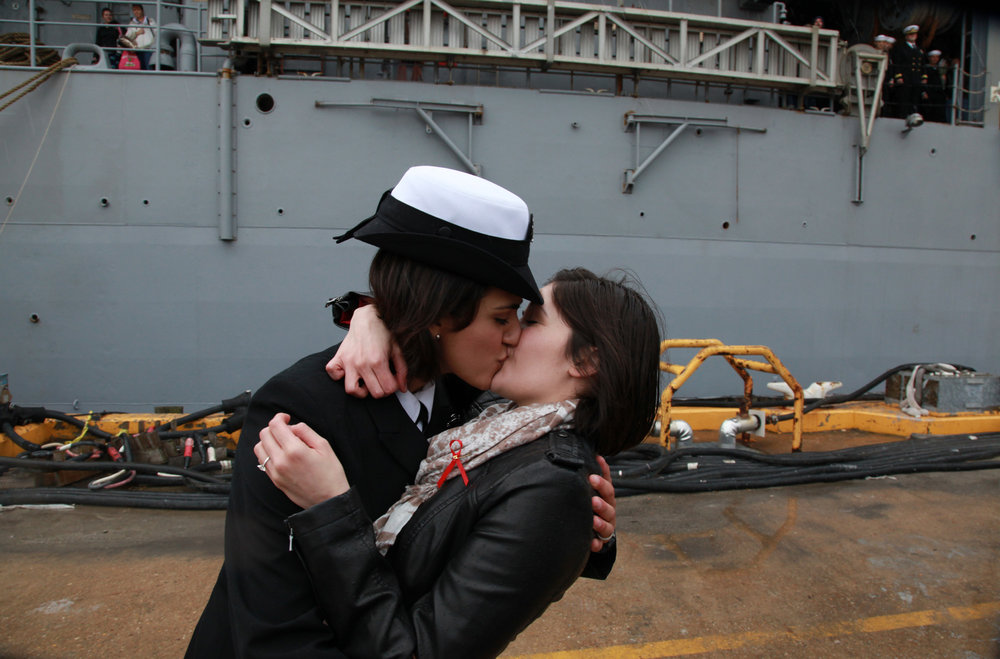 """Two female sailors kiss as the Navy tradition of """"first kiss""""catches up with repeal of the """"don't ask, don't tell"""" policy that previously barred openly gay men and women from serving in the U.S. military."""