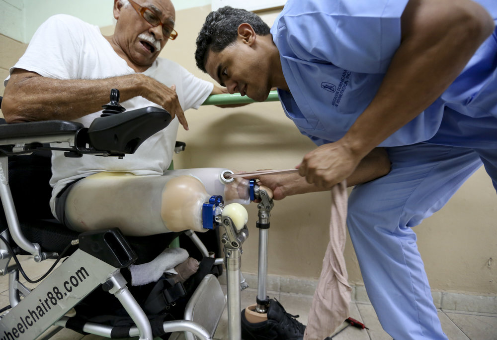Fitting prosthetic legs on a patient.