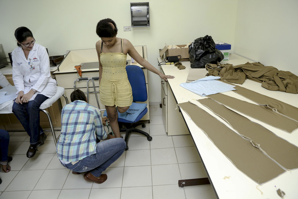 A patient is fitted for specialized clothing at a Physician's for Peace sponsored burn clinic in The Dominican Republic.
