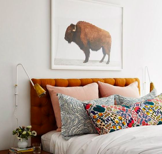Floral pillows matched with masculine art.